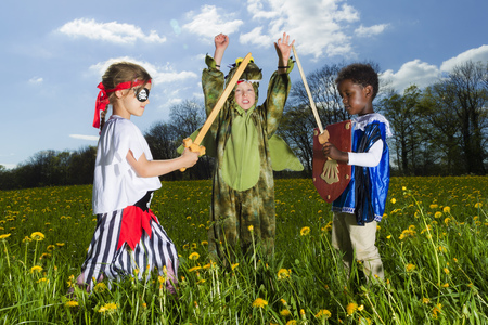 Boys playing dress up outdoors