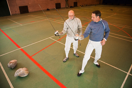 60 64 years: Senior and mature men fencing together