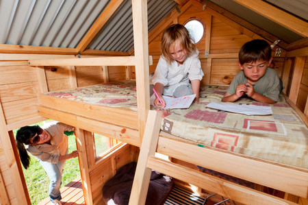 bunkbed: Mother looking in on children in playhouse