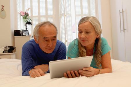 silver surfer: Older couple using tablet computer