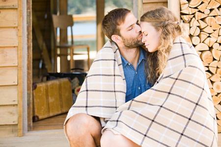 africa kiss: Couple enjoying lakeside vacation LANG_EVOIMAGES