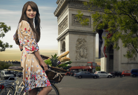 histories: Woman riding bicycle by Arc de Triomphe
