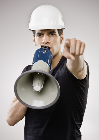 Man in hard hat using megaphone