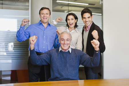 front desk: Business people cheering in office