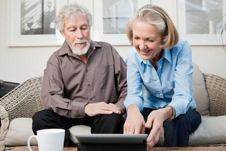 silver surfer: Senior couple with digital camera