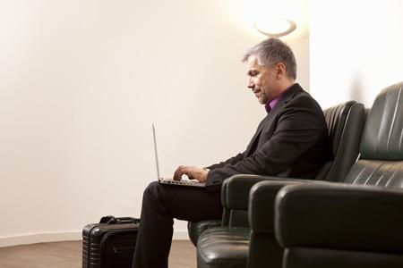 negative area: Businessman using Laptop