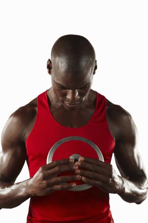 discus: Athlete examining discus