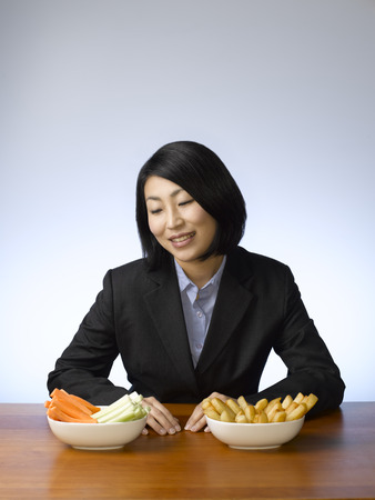 front desk: Businesswoman deciding what to eat