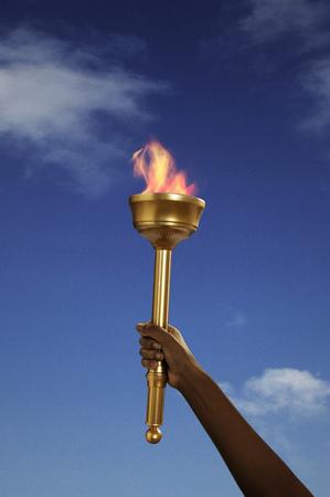 accomplishes: Hand holding flaming baton LANG_EVOIMAGES