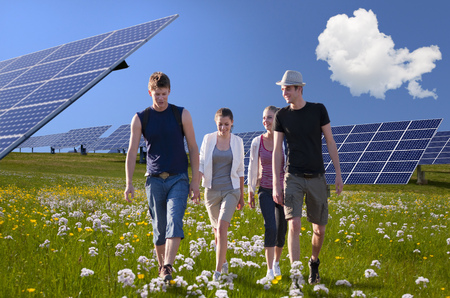 People walking by solar panels LANG_EVOIMAGES