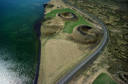 curve road: Aerial view of volcano craters by road