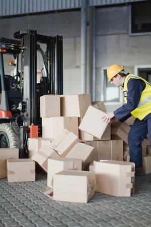 careless: Worker loading boxes onto forklift