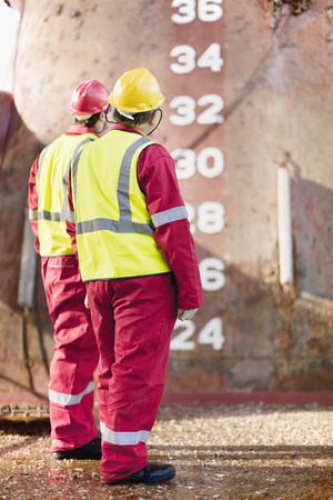 numeric: Workers standing on oil rig