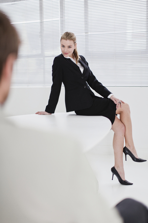 Businesswoman flirting with colleague