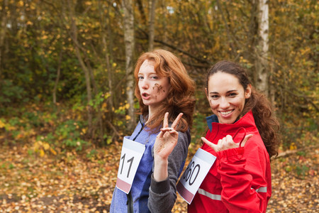 numeric: Young women smiling in forest,portrait