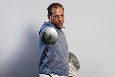 60 64 years: Portrait of senior man in fencing suit