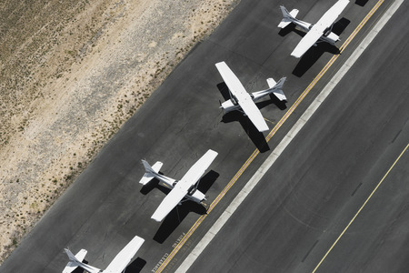 st kilda: Aerial view of four airplanes on runway, St Kilda, Melbourne, Victoria, Australia LANG_EVOIMAGES