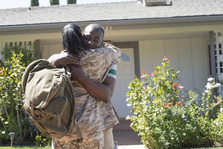 fatigues: Female soldier hugging husband on homecoming