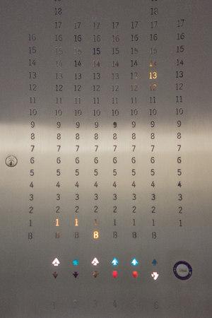 numeric: Close up of illuminated elevator information panel LANG_EVOIMAGES