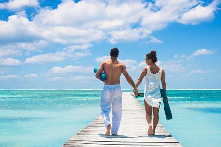 honeymooner: Young couple walking on pier, San Pedro, Belize