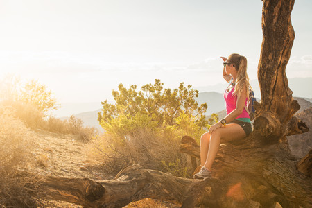 joshua: Woman taking break on mountain, Joshua Tree National Park, California, US