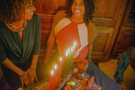 kwanzaa: Family celebrating Kwanzaa LANG_EVOIMAGES