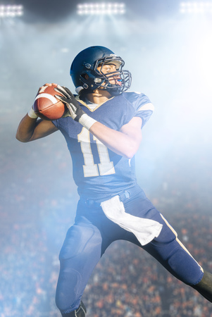 numeric: Teenage American football player jumping with ball