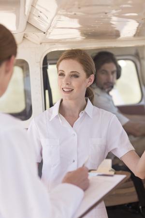 rescuing: Medical staff talking beside plane, Wellington, Western Cape, South Africa LANG_EVOIMAGES