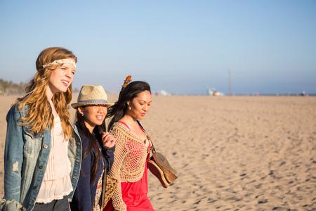 santa monica: Friends walking, Santa Monica Pier, Santa Monica Beach, US