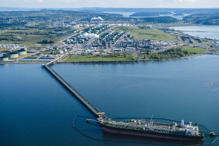 High angle view of oil transfer between coastal oil refinery and oil tanker