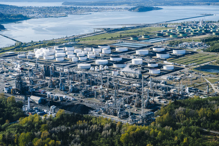 High angle view of coastal oil refinery  with oil storage tanks