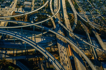 Aerial view of curved flyovers and multi lane highways, Los Angeles, California, USA