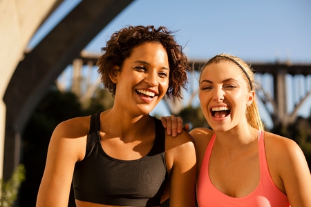 arroyo: Joggers laughing under arch bridge, Arroyo Seco Park, Pasadena, California, USA
