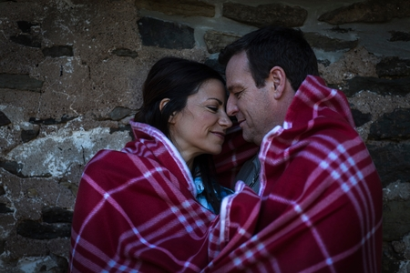 50 54 years: Romantic mature couple face to face wrapped in blanket at night LANG_EVOIMAGES