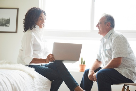60 64 years: Mature senior couple using laptop in bedroom LANG_EVOIMAGES