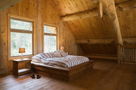 mezzanine: King size bed with wooden bed frame in the master bedroom, on  mezzanine