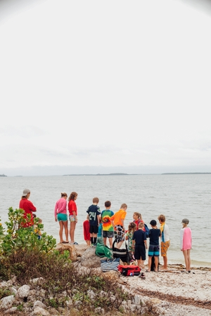 7 8: Rear view of large group of children on beach, Sanibel Island, Pine Island Sound, Florida, USA