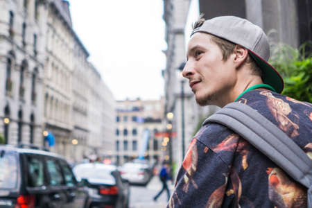 le cap: Young man on street, Le Plateau, Montreal, Quebec, Canada