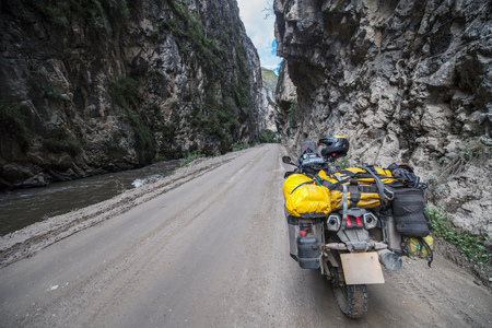 ancash: Touring motorbike on a dirt road in Ca��n del Pato, Casca, Ancash, Peru, South America LANG_EVOIMAGES