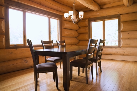 Wooden Dining Table And High-back Chairs In Dining Room Of A ...