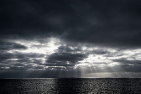 guadalupe island: Sunbeams through clouds over sea, Guadalupe Island, Mexico LANG_EVOIMAGES
