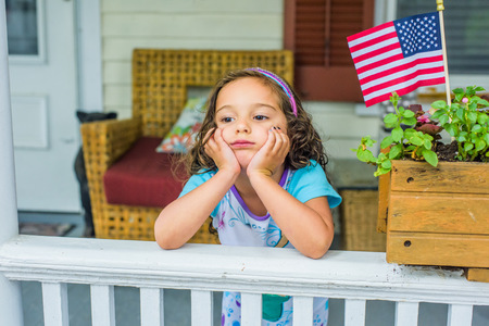 elbow band: Bored girl waiting on porch on Independence Day