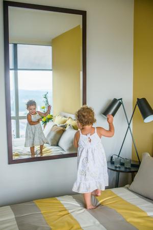 mirror image: Girl dancing in front of mirror in bedroom