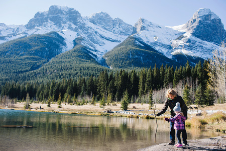 canmore: Grandmother and granddaughter beside river, Three Sisters, Rocky Mountains, Canmore, Alberta, Canada LANG_EVOIMAGES