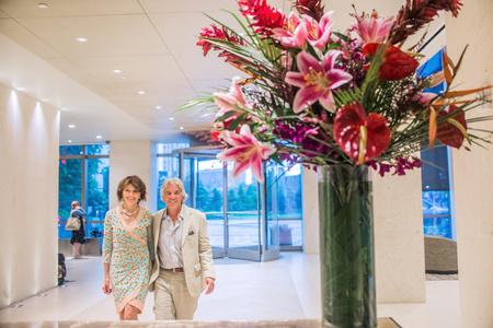 60 65 years: Senior couple walking through hotel foyer