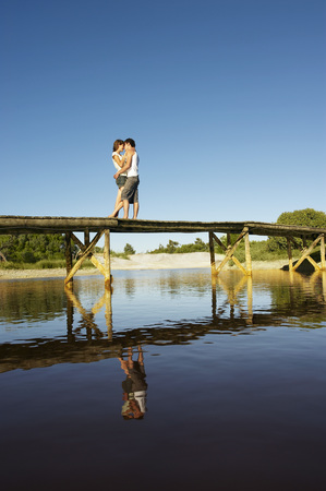 africa kiss: Teenage couple kissing on jetty LANG_EVOIMAGES