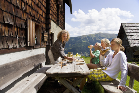 10 15 years: family having picnic at mountain hut