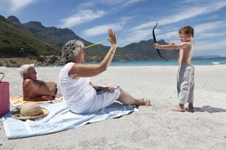 50 54 years: Boy shooting grandmother with toy arrow