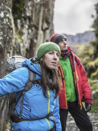 Couple hiking in rocky landscape LANG_EVOIMAGES