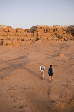 San Rafael Swell: Hikers exploring rock formations LANG_EVOIMAGES